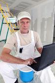 Painter using laptop — Stock Photo