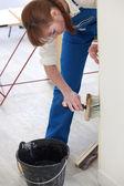Woman wallpapering — Stock Photo