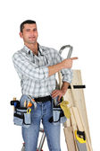 Carpenter stood with step ladder — Stock Photo