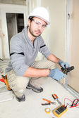 Electrician wiring up new home — Stock Photo