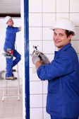 Man fixing an electrical outlet — Stock Photo