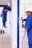 Tradesman using an electric screwdriver — Stock Photo