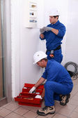 Workers renovating a house — Stock Photo
