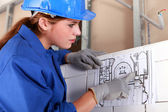 Woman with electrical diagram — Stock Photo