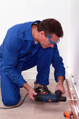 Plumber using a drill to install copper pipes — Stock Photo