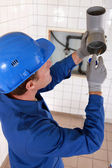 Plumber gluing grey water pipes — Stock Photo