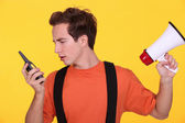 Confused man with a loudspeaker and walky-talky — Stock Photo