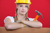Craftswoman holding a hammer — Stock Photo