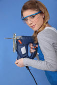 Attractive woman with band-saw — Stock Photo