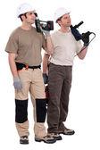 Workmen holding drills — Stock Photo