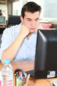 Frustrated student in front of his computer — Stock Photo
