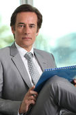 Businessman with notepad — Stock Photo