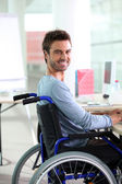Young man smiling in wheelchair — Stock Photo
