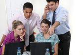 Colleagues gathered around laptop — Stock Photo