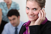 Female office worker on the telephone — Stock Photo