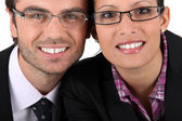 Smiling man woman wearing pairs of eyeglasses — Stock Photo