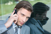 Elegant young man on phone — Stock Photo
