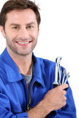 Man with spanners — Stock Photo