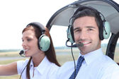 Man and woman in the cockpit of a light aircraft waiting for takeoff — Stock Photo