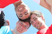 Guys with heads together — Stock Photo