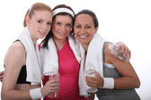 Gym buddies with bottles of water — Stock Photo