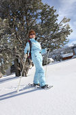 A mature woman doing snow board — Stock Photo