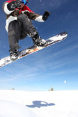 Snowboarder gliding through the air — Stock Photo