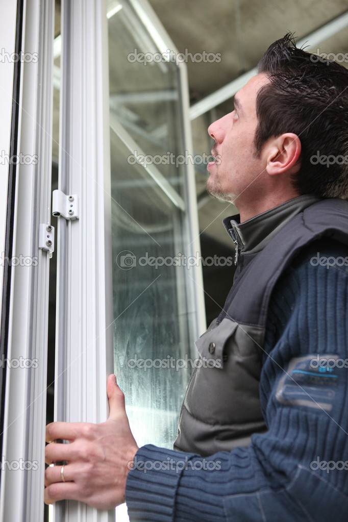 Man fitting windows — Stock Photo #7810756