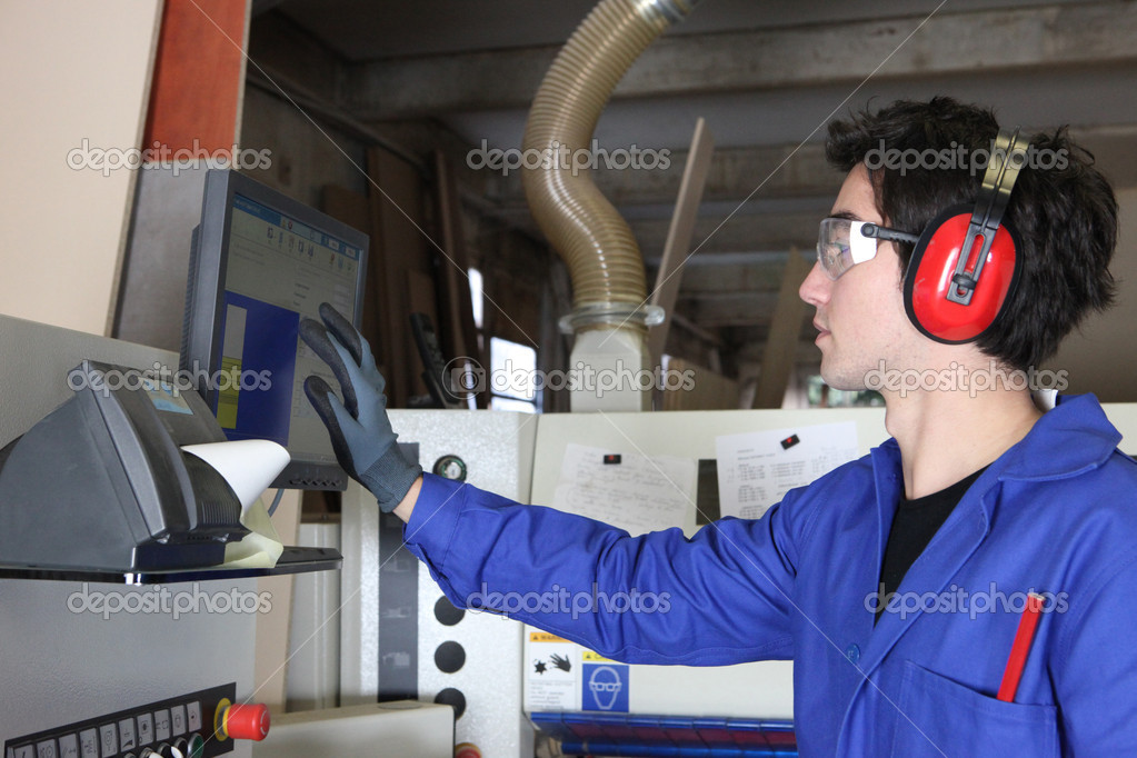 Young man operating factory machinery — Stock Photo #7811970