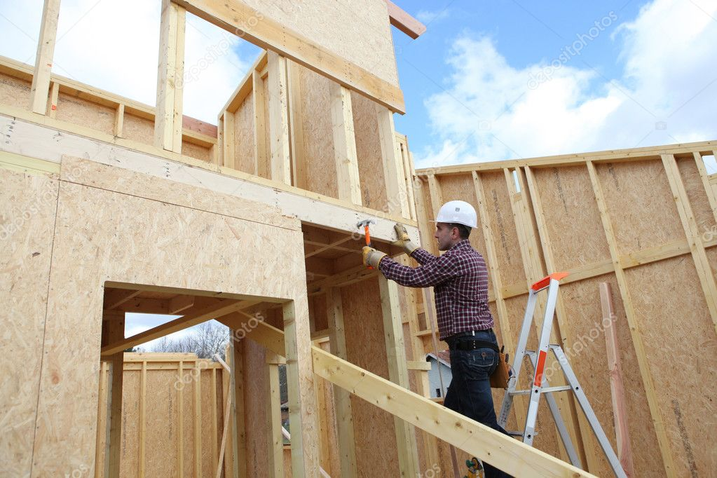 Carpenter at work in construction site — Stock Photo #7812857