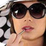 Lady applying lipstick — Stock Photo