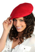 Young woman wearing a red beret — Stock Photo