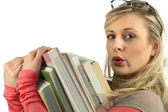 Young woman with a pile of books in her arms — Stock Photo