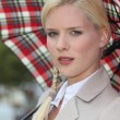 Snobby woman holding an umbrella — Stockfoto