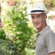Mature gentleman in garden — Stock Photo