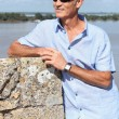 Senior tourist in Blaye, France - Stock Photo