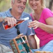 Couple enjoying a picnic together - Stock Photo