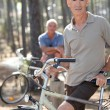 Two older men out for a bike ride - Stock Photo