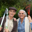 Couple of pensioners gardening — Stock Photo