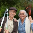 Couple of pensioners gardening — Stock Photo #7892430