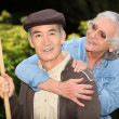 Senior couple playing outdoors — Stock Photo