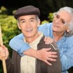 Senior couple playing outdoors — Stock Photo #7892451