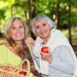 Stock Photo: Women gathering apples