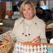 Woman buying eggs at market — Stock Photo #7892596