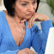 Annoyed womlooking at her laptop — Stock Photo #7892705