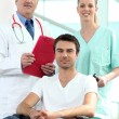 Doctor and nurse with patient in wheelchair — Stock Photo #7892920