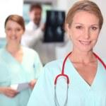 Female nurse in X-ray room. — Stock Photo