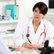 Stock Photo: Doctor consulting with a patient