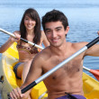 Couple kayaking - Stock Photo