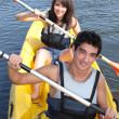Teenagers canoeing - Stock Photo